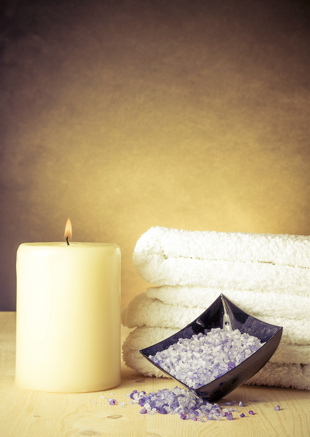 Spa massage border background with towel stacked and sea salt, warm atmosphere